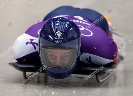 Kristan Bromley of Great Britain starts his run during the men's skeleton training at the 2014 Winter Olympics, in Krasnaya Polyana, Russia