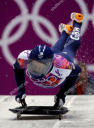 Stock Picture of Kristan Bromley of Great Britain starts his third heat during the men's skeleton competition at the 2014 Winter Olympics, in Krasnaya Polyana, Russia