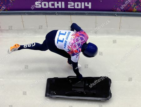 Kristan Bromley of Great Britain starts his first run during the men's skeleton competition at the 2014 Winter Olympics, in Krasnaya Polyana, Russia