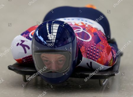 Stock Image of Kristan Bromley of Great Britain starts his first run during the men's skeleton competition at the 2014 Winter Olympics, in Krasnaya Polyana, Russia