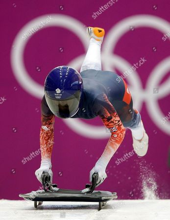 Shelley Rudman of Great Britain starts a training run for the women's skeleton during the 2014 Winter Olympics, in Krasnaya Polyana, Russia