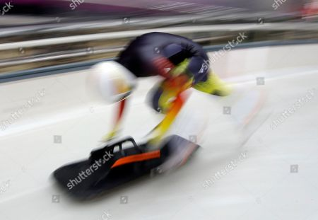 Germany's Anja Huber starts her training run in the women's skeleton at the 2014 Winter Olympics, in Krasnaya Polyana, Russia