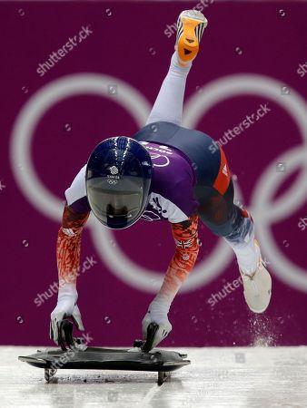 Shelley Rudman of Britain starts a run during women's skeleton training at the 2014 Winter Olympics, in Krasnaya Polyana, Russia