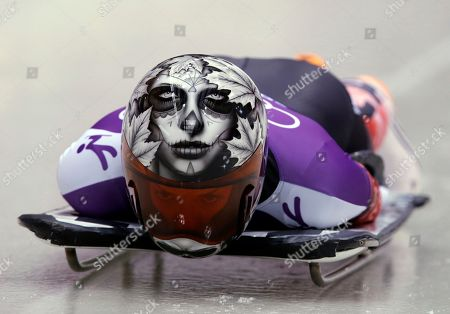Sarah Reid of Canada starts a run during women's skeleton training at the 2014 Winter Olympics, in Krasnaya Polyana, Russia