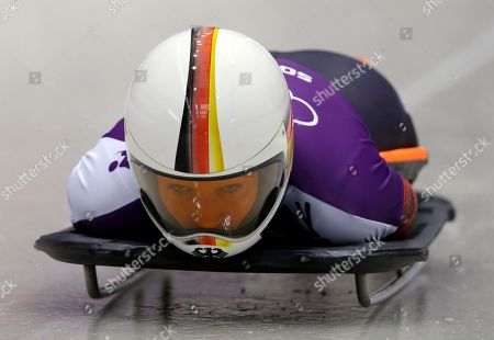 Anja Huber of Germany starts a run during women's skeleton training at the 2014 Winter Olympics, in Krasnaya Polyana, Russia