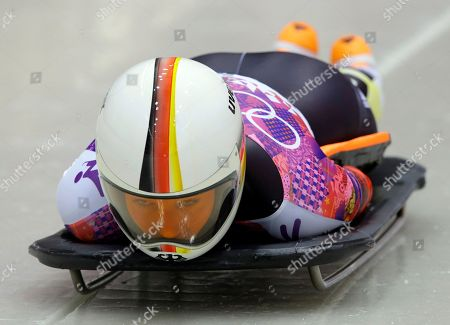 Anja Huber of Germany starts her first run during the women's skeleton competition at the 2014 Winter Olympics, in Krasnaya Polyana, Russia