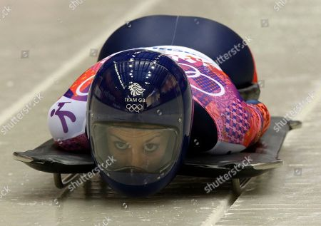 Shelley Rudman of Great Britain starts her first run during the women's skeleton competition at the 2014 Winter Olympics, in Krasnaya Polyana, Russia