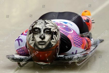 Sarah Reid of Canada starts her first run during the women's skeleton competition at the 2014 Winter Olympics, in Krasnaya Polyana, Russia