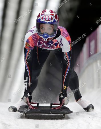 Noelle Pikus-Pace of the United States brakes after her third run during the women's skeleton competition at the 2014 Winter Olympics, in Krasnaya Polyana, Russia