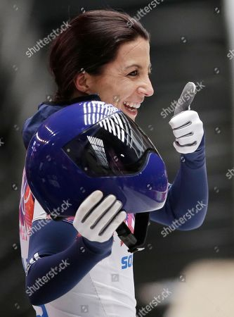 Shelley Rudman of Great Britain acknowledges fans after her final run during the women's skeleton competition at the 2014 Winter Olympics, in Krasnaya Polyana, Russia
