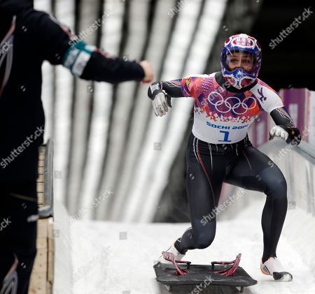 Noelle Pikus-Pace of the United States celebrates her silver medal win in the finish area after the women's skeleton competition at the 2014 Winter Olympics, in Krasnaya Polyana, Russia