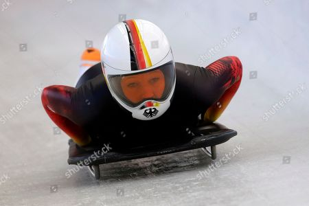 Anja Huber from Germany takes a turn during a training session for the women's skeleton at the 2014 Winter Olympics, in Krasnaya Polyana, Russia