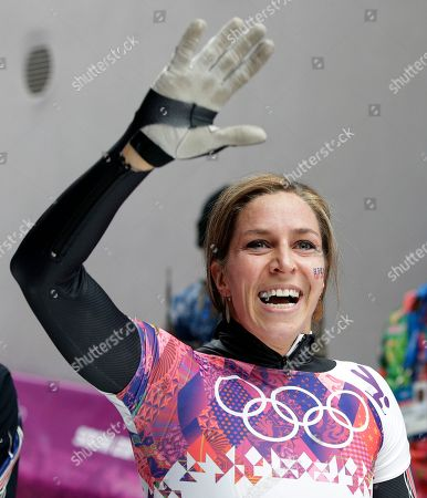 Noelle Pikus-Pace of the United States waves to supporters after her third run during the women's skeleton competition at the 2014 Winter Olympics, in Krasnaya Polyana, Russia