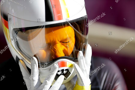 Germany's Anja Huber takes her helmet off after finishing her training run in the women's skeleton at the 2014 Winter Olympics, in Krasnaya Polyana, Russia