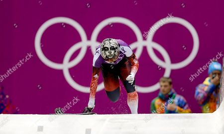 Sarah Reid of Canada starts a training run for the women's skeleton during the 2014 Winter Olympics, in Krasnaya Polyana, Russia