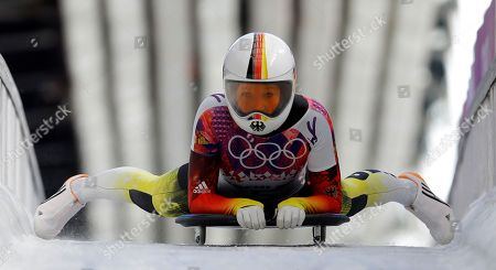 Anja Huber of Germany brakes in the finish area after her first run during the women's skeleton competition at the 2014 Winter Olympics, in Krasnaya Polyana, Russia