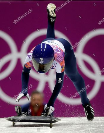 Stock Photo of Shelley Rudman of Great Britain starts her final run during the women's skeleton competition at the 2014 Winter Olympics, in Krasnaya Polyana, Russia