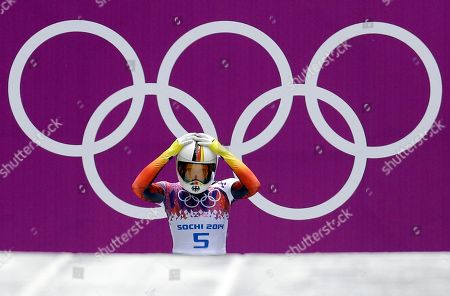 Anja Huber of Germany prepares for her third run during the women's skeleton competition at the 2014 Winter Olympics, in Krasnaya Polyana, Russia