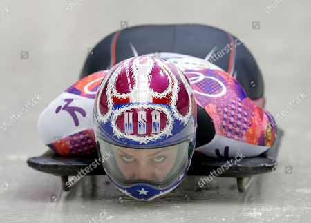 Noelle Pikus-Pace of the United States starts her third run during the women's skeleton competition at the 2014 Winter Olympics, in Krasnaya Polyana, Russia