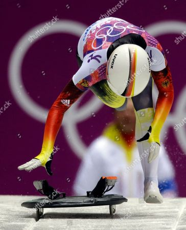 Anja Huber of Germany starts her final run during the women's skeleton competition at the 2014 Winter Olympics, in Krasnaya Polyana, Russia