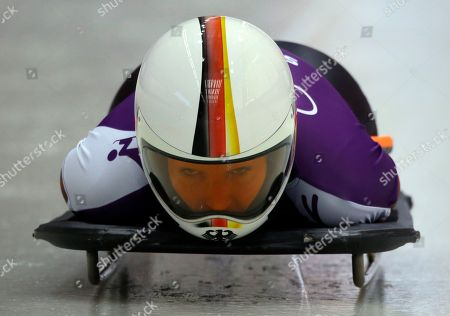 Anja Huber of Germany speeds down the track during the women's skeleton training at the 2014 Winter Olympics, in Krasnaya Polyana, Russia