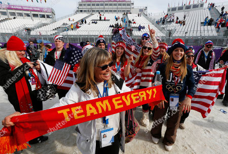 Lauren Anderson, the mother of U.S. snowboarder Jamie Anderson celebrates with fans after Jamie Anderson won the women's snowboard slopestyle final at the 2014 Winter Olympics, in Krasnaya Polyana, Russia