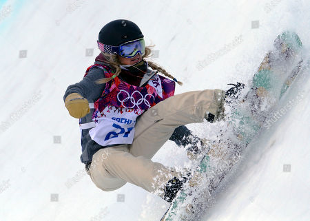 United States' Hannah Teter competes in the women's snowboard halfpipe qualifying at the Rosa Khutor Extreme Park, at the 2014 Winter Olympics, in Krasnaya Polyana, Russia