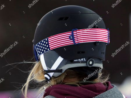 United States' Hannah Teter wears goggles with a strap in the colors of the U.S. flag while competing in the women's snowboard halfpipe qualifying at the Rosa Khutor Extreme Park, at the 2014 Winter Olympics, in Krasnaya Polyana, Russia