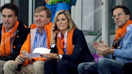 Dutch King Wilem-Alexander, second left, and Queen Maxima, Prime Minister Mark Rutte, right, and KLM CEO and IOC member Camiel Eurlings, left, watch the men's 5,000-meter speedskating race at the Adler Arena Skating Center at the 2014 Winter Olympics in Sochi, Russia