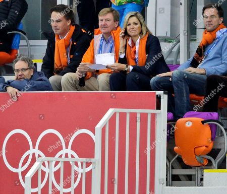 Dutch King Wilem-Alexander, center, and Queen Maxima, Prime Minister Mark Rutte, right, and KLM CEO and IOC member Camiel Eurlings, second left, watch the men's 5,000-meter speedskating race at the Adler Arena Skating Center at the 2014 Winter Olympics in Sochi, Russia