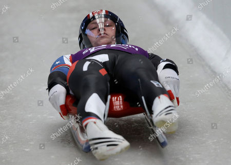 Aidan Kelly from the US starts a run during a training session for the men's singles luge at the 2014 Winter Olympics, in Krasnaya Polyana, Russia