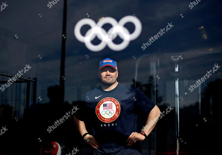 Stock Picture of Steve Holcomb United States bobsled pilot Steve Holcomb poses for photographers during a media tour of the fitness center in the Coastal Cluster athlete's village at the 2014 Winter Olympics, in Sochi, Russia