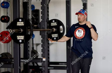 Stock Picture of Steve Holcomb United States bobsled pilot Steve Holcomb works out in the fitness center of the Coastal Cluster athlete's village at the 2014 Winter Olympics, in Sochi, Russia