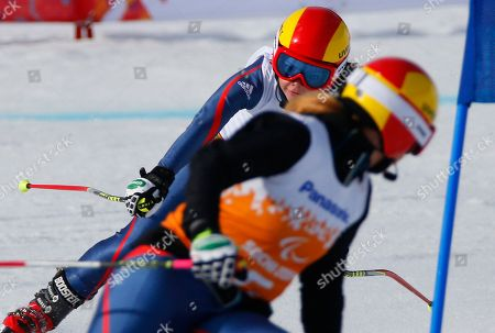 Jade Etherington, Caroline Powell Great Britain's Jade Etherington, left, and her guide Caroline Powell race to win silver medal in the women's downhill, visually impaired event at the 2014 Winter Paralympic, in Krasnaya Polyana, Russia