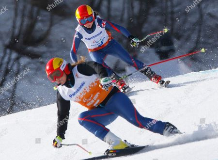 Jade Etherington, Caroline Powell Great Britain's Jade Etherington, above, and her guide Caroline Powell race to win bronze medal in the alpine skiing, ladies, Super-G, visually Impaired event at the 2014 Winter Paralympic, in Krasnaya Polyana, Russia