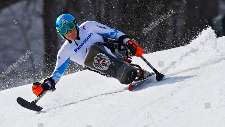 Claudia Loesch Claudia Loesch of Austria races to win silver medal in the alpine skiing, ladies, Super-G, sitting event at the 2014 Winter Paralympics, in Krasnaya Polyana, Russia