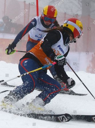 Jade Etherington, Caroline Powell Britain's Jade Etherington, left, and her guide Caroline Powell race during the women's super combined, slalom, visually impaired event at the 2014 Winter Paralympic, in Krasnaya Polyana, Russia