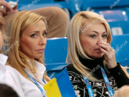 Yana Rudkovskaya, right, the wife of Russian figure skater Evgeni Plushenko, watches the team ice dance short dance figure skating competition with retired figure skater Tatiana Navka of Belarus at the Iceberg Skating Palace during the 2014 Winter Olympics in Sochi, Russia. In Russia, Plushenko is practically royalty, and being his wife has its benefits