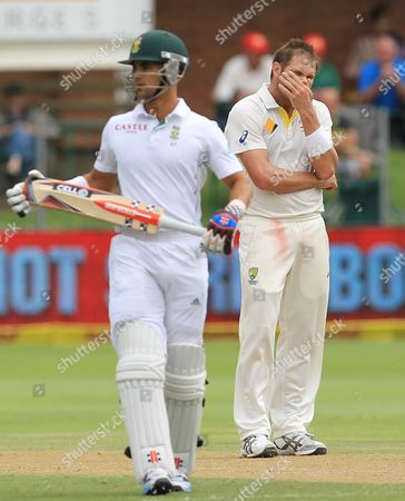 Ryan Harris, JP Duminy Australia's bowler Ryan Harris, right, reacts after six runs were scored by South Africa's batsman JP Duminy, left, from his delivery on the second day of their 2nd cricket test match at St George's Park in Port Elizabeth, South Africa