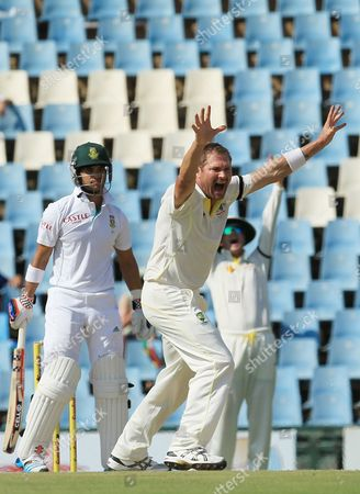 Australia's bowler Ryan Harris, right, unsuccessfully appeals for LBW against South Africa's batsman JP Duminy, left, on the second day of their their cricket test match at Centurion Park in Pretoria, South Africa