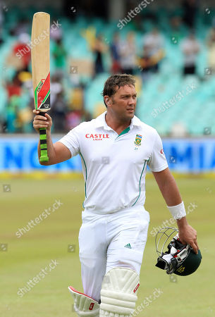 South Africa's batsman Jacques Kallis waves his bat as he salutes the fans after he was dismissed for 115 runs on the forth day of their cricket test match against India at Kingsmead stadium in Durban, South Africa