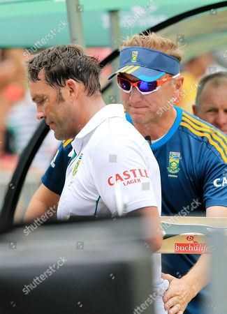 South Africa's batsman Jacques Kallis, left, walks back to the players pavilion as team member Allan Donald, right, pats his back after being dismissed for 115 runs on the forth day of their cricket test match against India at Kingsmead stadium in Durban, South Africa
