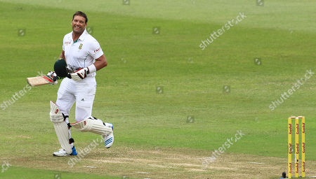 South Africa's batsman Jacques Kallis celebrates his century on the forth day of their cricket test match against India at Kingsmead stadium in Durban, South Africa