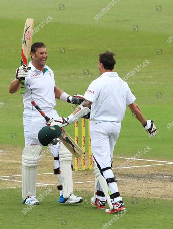 South Africa's batsman Jacques Kallis, left, celebrates his century with teammate Dale Steyn on the forth day of their cricket test match against India at Kingsmead stadium in Durban, South Africa
