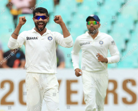 India's bowler Ravindra Jadeja, left, celebrates as teammate Rohit Sharma, right, watches after dismissing South Africa's batsman Jacques Kallis, for 115 runs on the forth day of their cricket test match against India at Kingsmead stadium in Durban, South Africa