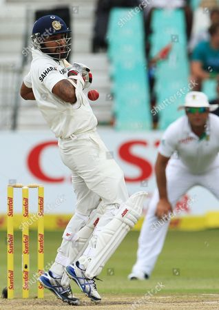 India's batsman Shikhar Dhawan, left, avoids a bouncer as South Africa's bowler Jacques Kallis, right, watches on the fourth day of their cricket test match at Kingsmead stadium, Durban, South Africa