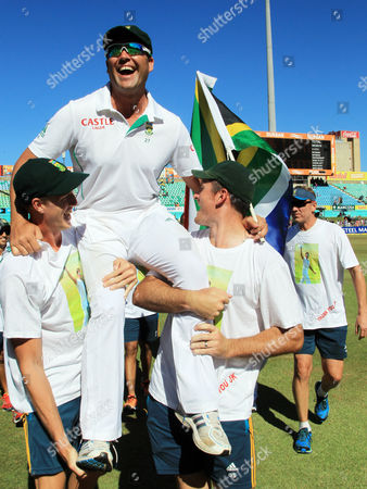 South Africa bowler Jacques Kallis is carried by teammates after winning their cricket test match against India on the final day at Kingsmead stadium, Durban, South Africa, . South Africa beat India by 10 wickets