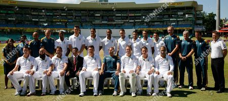 South Africa's cricket team and technical staff, Front Row L-R Morne Morkel, Hashim Amla, Jacques Kallis, Mohammed Moosajee (team manager/doctor), captain Graeme Smith, Russell Domingo (Head Coach), Abraham Benjamin de Villiers, Dale Steyn and Alviro Petersen. Back Row L-R, Lerato Malekutu (Media officer), Prasanna Angoram (Video Analyst), Zunaid Wadee (Close Protection Officer), Adrian Birrell (Assistant Coach), Vernon Philander, Kyle Abbott, Rory Kleinveldt, Robin Peterson, Francois du Plessis, Jean-Paul Duminy, Imran Tahir, Dean Elgar, Allan Donald (specialist bowling coach), Brandon Jackson (physiotherapist), Greg King (Conditioning coach) and Riaan Muller (team logistics), pose for a photograph before their fifth and final day of their cricket test match against India at Kingsmead stadium, Durban, South Africa, . South Africa beat India by 10 wickets