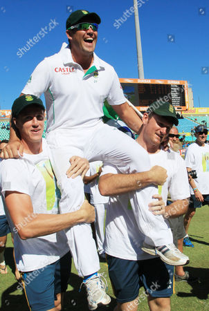 South Africa's bowler Jacques Kallis is carried by teammates after he retired from Test cricket at end of the fifth and final day of their cricket test match against India at Kingsmead stadium, Durban, South Africa, . South Africa beat India by 10 wickets