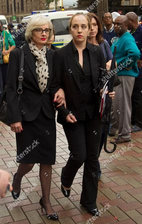 Oscar Pistorius Oscar Pistorius' aunt Lois Pistorius, left, with unidentified family member arrive back outside the high court after a lunch break in Pretoria, South Africa, . Pistorius is charged with murder for the shooting death of his girlfriend, Reeva Steenkamp, on Valentines Day in 2013